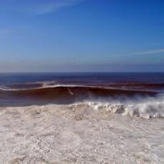 big wave surfer surfing nazare